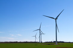 Wind turbine on blue sky Royalty Free Stock Photography