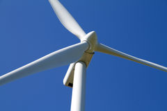 Wind turbine on blue sky Royalty Free Stock Photos