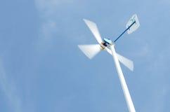 Wind turbine blue sky royalty free stock photography