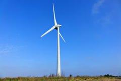 Wind turbine. On blue sky Royalty Free Stock Photos