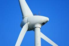 Wind turbine. On blue sky Stock Image