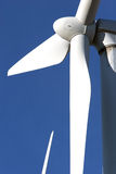 Wind turbine on blue sky - alternative energy Stock Image