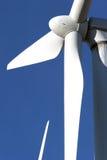 Wind turbine on blue sky - alternative energy Stock Image