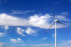 Wind turbine and blue sky with clouds Stock Photo