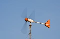 Wind turbine on the blue sky field. Stock Photo