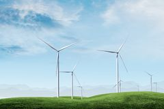 Wind turbine with blue sky. With green grass royalty free stock images