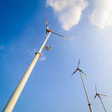 Wind turbine on blue sky Stock Images