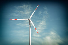 Wind turbine on blue sky. With toning effect Stock Photos