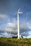 Wind turbine and boy. Royalty Free Stock Images