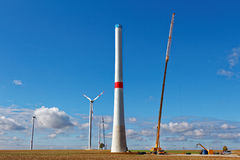 Wind turbine building site. A wind turbine erected by a crane on a sunny day in the German countryside Stock Photography