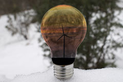 Wind turbine in a bulb on snow Stock Photography