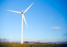 Wind turbine and car. Car and wind turbine windmill agriculture area field Stock Photography