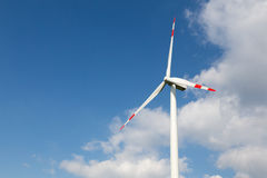 Wind turbine for clean energy production with blue sky Stock Photos