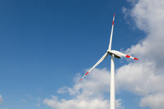 Wind turbine for clean energy production with blue sky Stock Photography