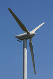 Wind turbine in a clear blue sky Royalty Free Stock Photo