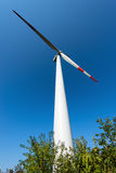 Wind Turbine on a Clear Blue Sky Stock Images
