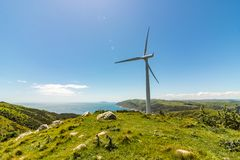 Wind Turbine On Cliff With Blue Sky stock photography