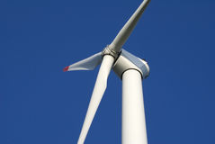 Wind turbine close-up. Close-up of wind turbine against blue sky royalty free stock photos