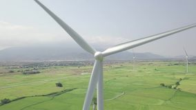 Wind turbine close up drone view. Wind power generation on energy station on green field aerial landscape. natural. Source and ecology conservation. Alternative stock footage