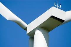 Wind turbine closeup. Close-up of wind turbine in blue sky Stock Image