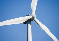 Wind turbine closeup. Close-up of wind turbine in blue sky royalty free stock photography