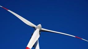Wind turbine closeup on the blue sky Stock Photos