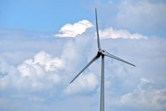 Wind turbine with cloud background Royalty Free Stock Photos