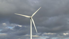 Wind turbine with clouds in the background stock footage