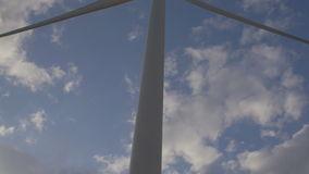 Wind turbine with clouds in the background stock video footage