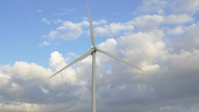 Wind turbine with clouds in the background. Wind turbines from the front. In the background are clouds and blue sky stock video footage