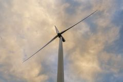 Wind turbine on a cloudy day royalty free stock image