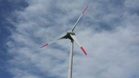 The wind turbine. A wind turbine with a cloudy sky in the background stock video