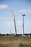Wind turbine construction. Large wind turbine under construction with a crane lift blue sky background Royalty Free Stock Photos