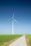 Wind turbine and country road Royalty Free Stock Photos