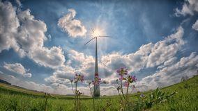 Wind turbine in countryside field Stock Image