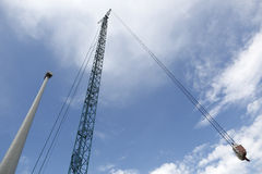 Wind turbine and crane Stock Photography
