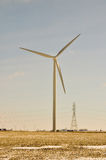 Wind Turbine Creates the Power. Behind Stock Photography