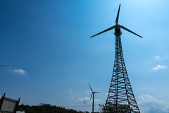 The wind turbine in the dam. On the mountain Stock Photography