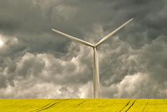 Wind turbine and dark sky Stock Photos