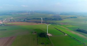 Aerial drone view on Wind Power, Turbine, Windmill, Energy Production. Green technology, a clean and renewable energy. A wind turbine is a device that converts stock video