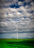 Wind Turbine in the Distance Under Cloudy Sky Royalty Free Stock Images