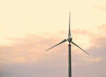 Wind turbine at dusk. Single wind turbine - Environmental clean energy generator Royalty Free Stock Photo