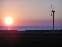 Wind turbine, dusk colours. Royalty Free Stock Photography