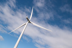 Wind turbine at dynamic angle. Wind turbine on a wind farm in Scotland, Europe. Dynamic angle against summer clouds Stock Images