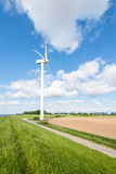 Wind turbine on the edge of a plowed field Stock Photography
