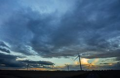 Wind turbine for electrical power generation in agricultural field on cloudy day in Normandy, France. Renewable energy. Wind turbine for electrical power Stock Photography