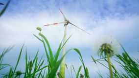 Wind turbine electricity generator on sky background. Dandelion clock. Static
