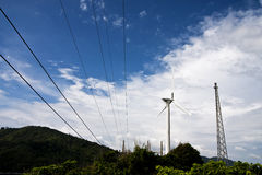 Wind turbine with electricity station Stock Image