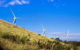 Wind turbine energy power. Wind turbine on blue sky and mountain for background Royalty Free Stock Images