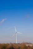 Wind turbine in english countryside. Single Wind turbine in english countryside  on  blue sky autumn day Royalty Free Stock Photo